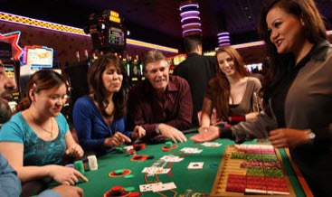 group of people sitting around casino game table at hotels and casinos