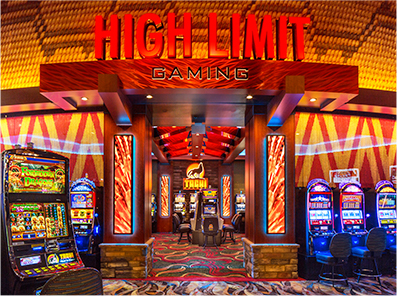 "A red sign that reads ""High Limit Gaming"" accompanied by slot machine games in a Lemoore, California casino"