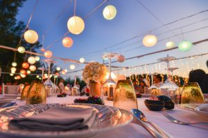 Outdoor table setting for a  wedding venue with lantern lights at night